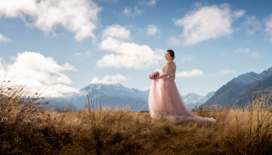 Bride in pink dress with Mountains in background