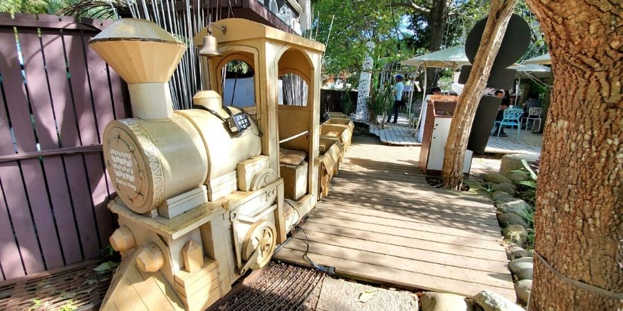 The cardboard train loops around the park in Carton King.
