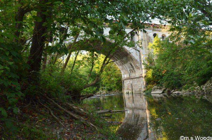 haunted-bridge-reflects-on-water-avon-indiana