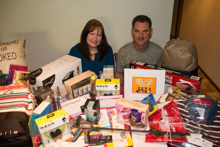 Tony and Diane Murtagh from YVFM surrounded by some of the prizes
