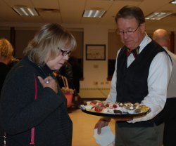 Mount Prospect Village Trustee Paul Hoefert serves desserts prior to the start of the live auction.