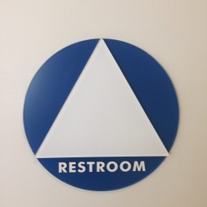 A restroom sign with a white triangle instead of a man or woman stick figure