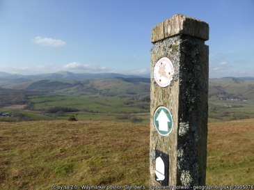 Waymarker post on Glyndwr's Way above the Dyfi Valley in March Lovely outlook from this spot.