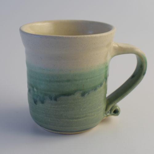 green and white stoneware pottery mug