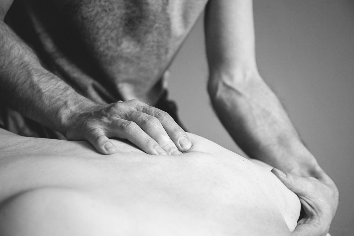 Person having their back massaged