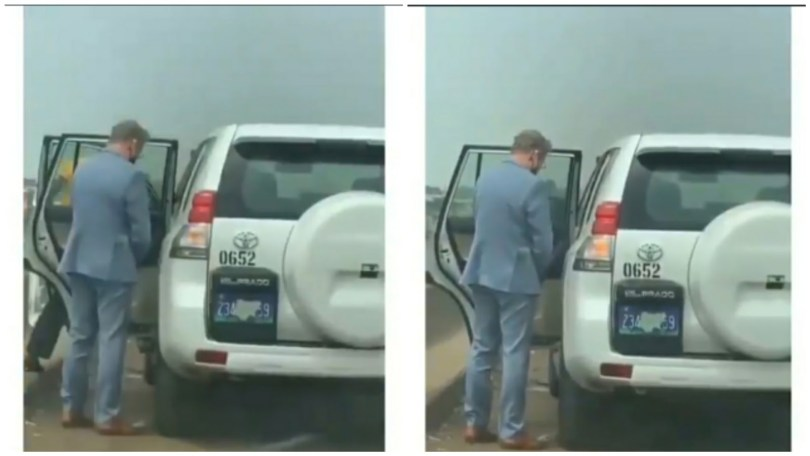 """(Video) """"He can't try it in his country"""" – Nigerians react as Oyinbo Diplomat urinates on the road in the Lagos"""