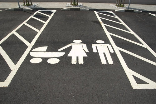 A man with his kids in a family-friendly parking spot raises the ire of two women. Why can't dads be seen as the primary caregivers of their kids? #dads #fathers #fatherhood