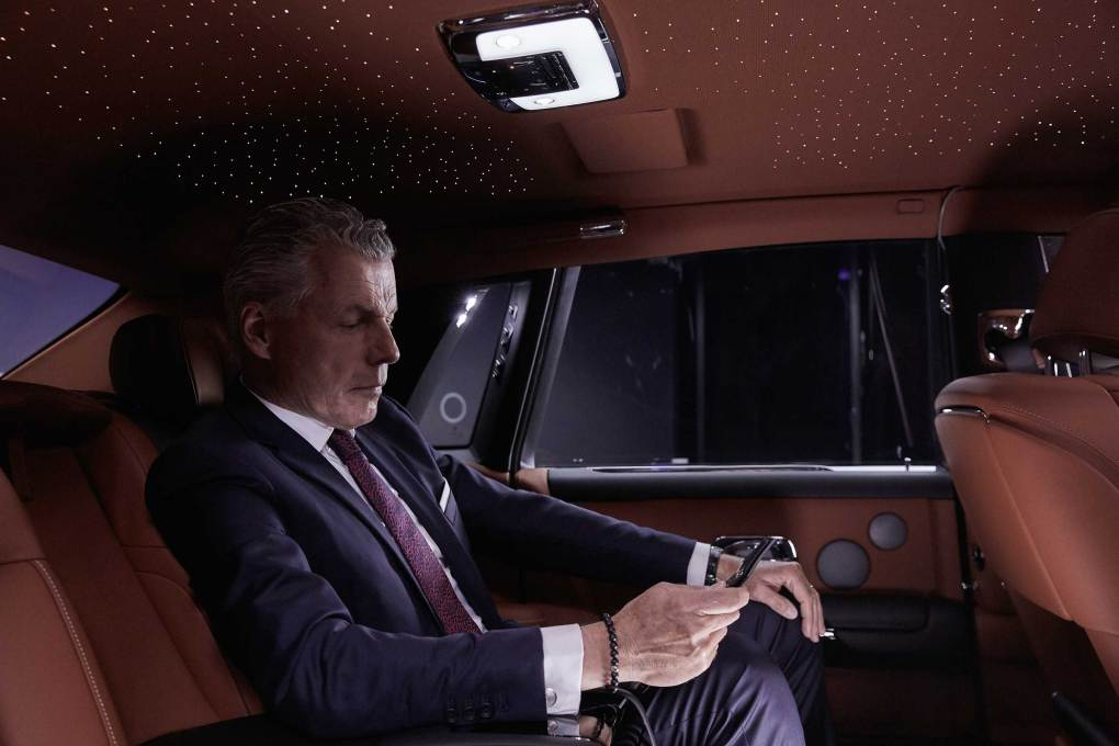 Torsten Müller-Ötvös, Chief Executive Officer, Rolls-Royce Motor Cars, sits within the New Phantom.