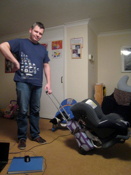 fastening a car seat to a suitcase, airport money saving tips