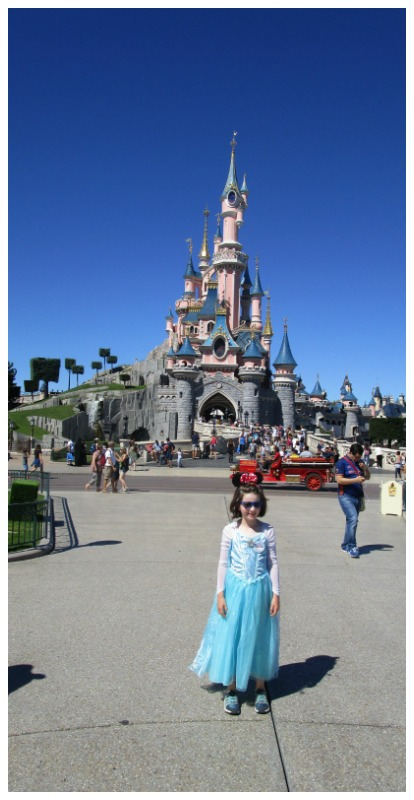 H in front of the Disneyland Castle