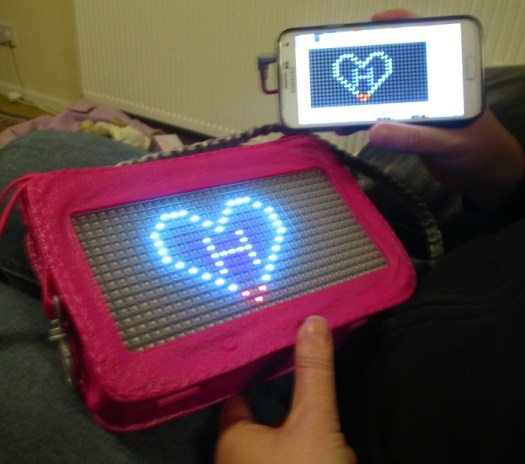 Project Mc2 Pixel Purse phone plugged in transferring design