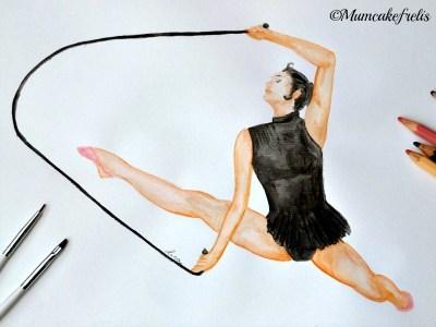 ginnasta in body nero che salta la fune ginnastica ritmica