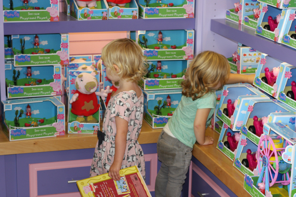 Amy checking out the Peppa Pig toy store at Peppa Pig World Paulton Park