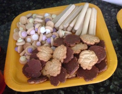 monkey biscuits, tropical flowers (iced gems) and sticks (choc fingers)