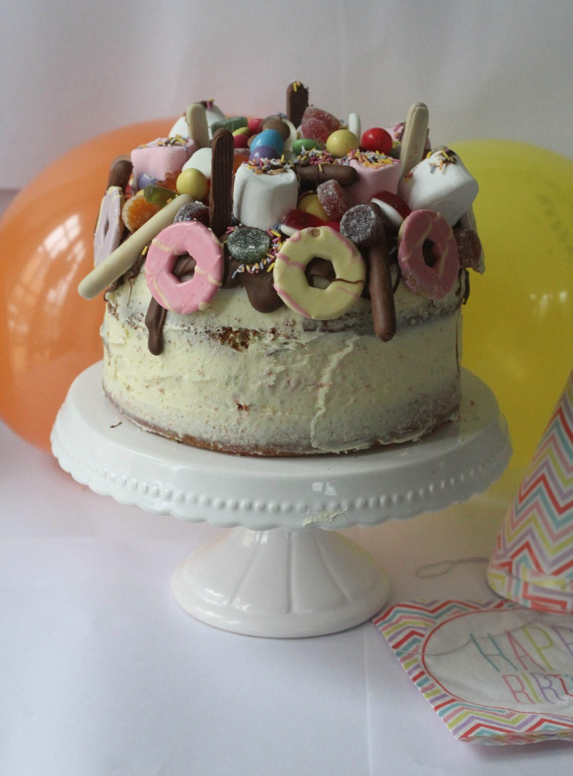 sweetie & Biscuit Topped Rainbow Cake