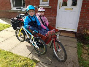 bikes and kids on a cargo bike