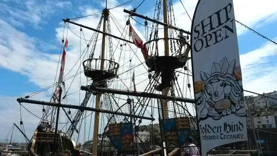 View of the Golden Hind Brixham from the harbourside, rigging silhoutted against the blue sky