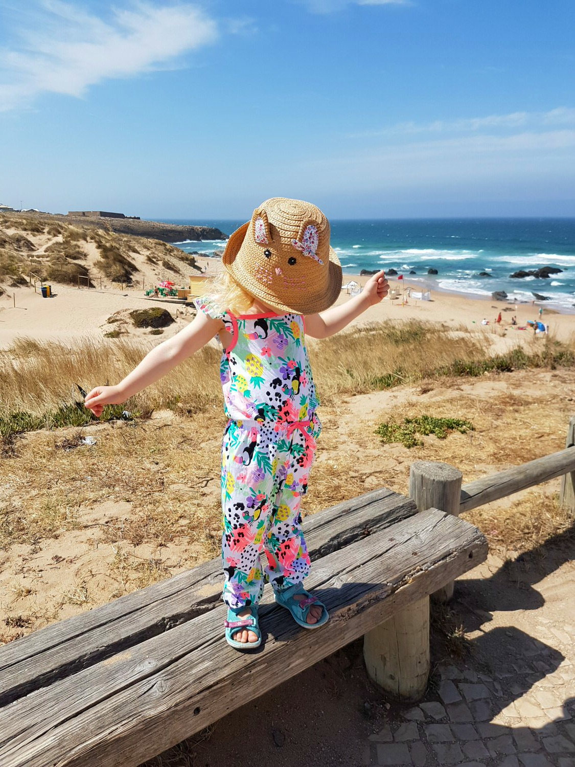 Turning up the colour and fun with some matching bright outfits for a summer holiday or day at the beach from George At Asda - my daughter in Porgual, in printed jumpsuit for the #GeorgeMiniMe challenge