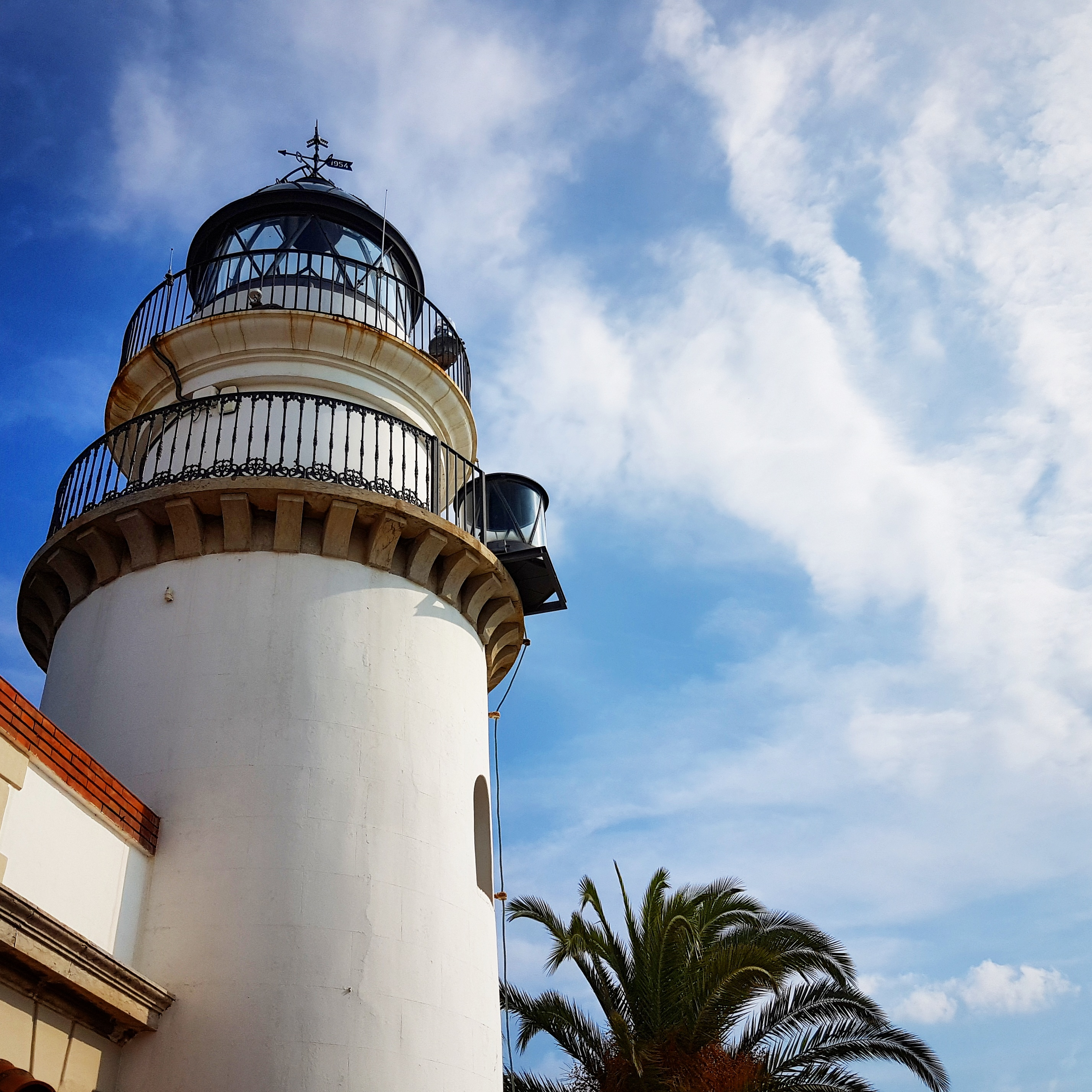 The lighthouse at Calella against the blue sky. My photo tour of Costa Barcelona