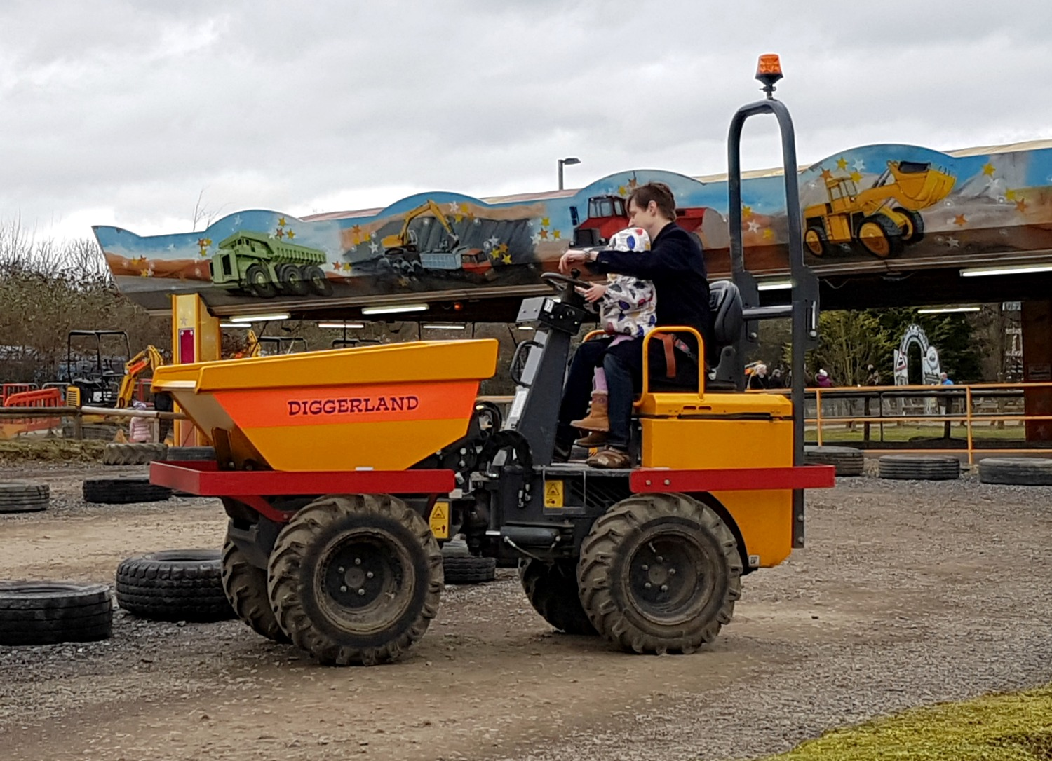 My daughter driving a dumper truck at Diggerland Kent - one of the attractions on this family day out