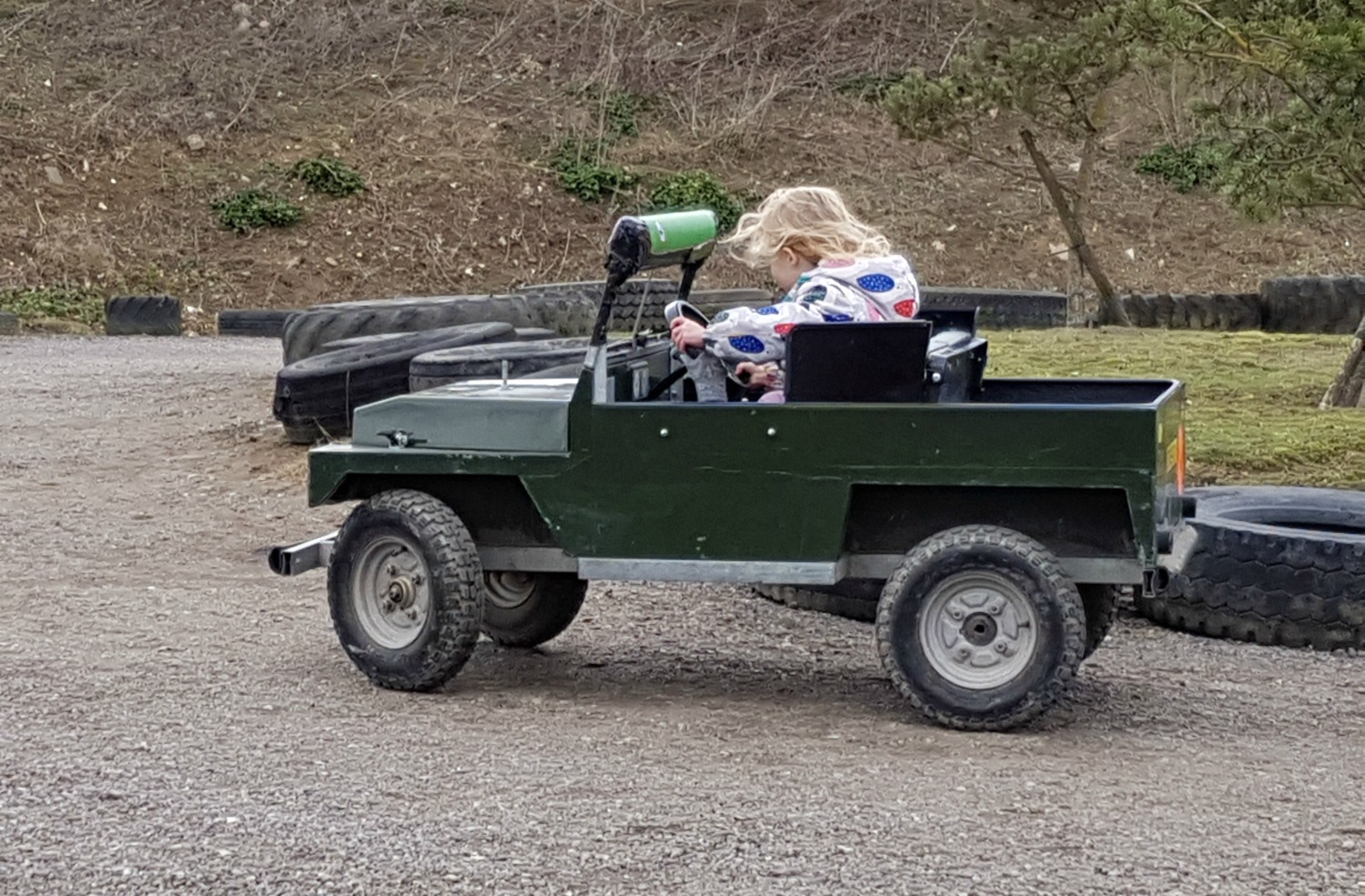 My daughter driving a small Jeep at Diggerland Kent - one of the attractions on this family day out