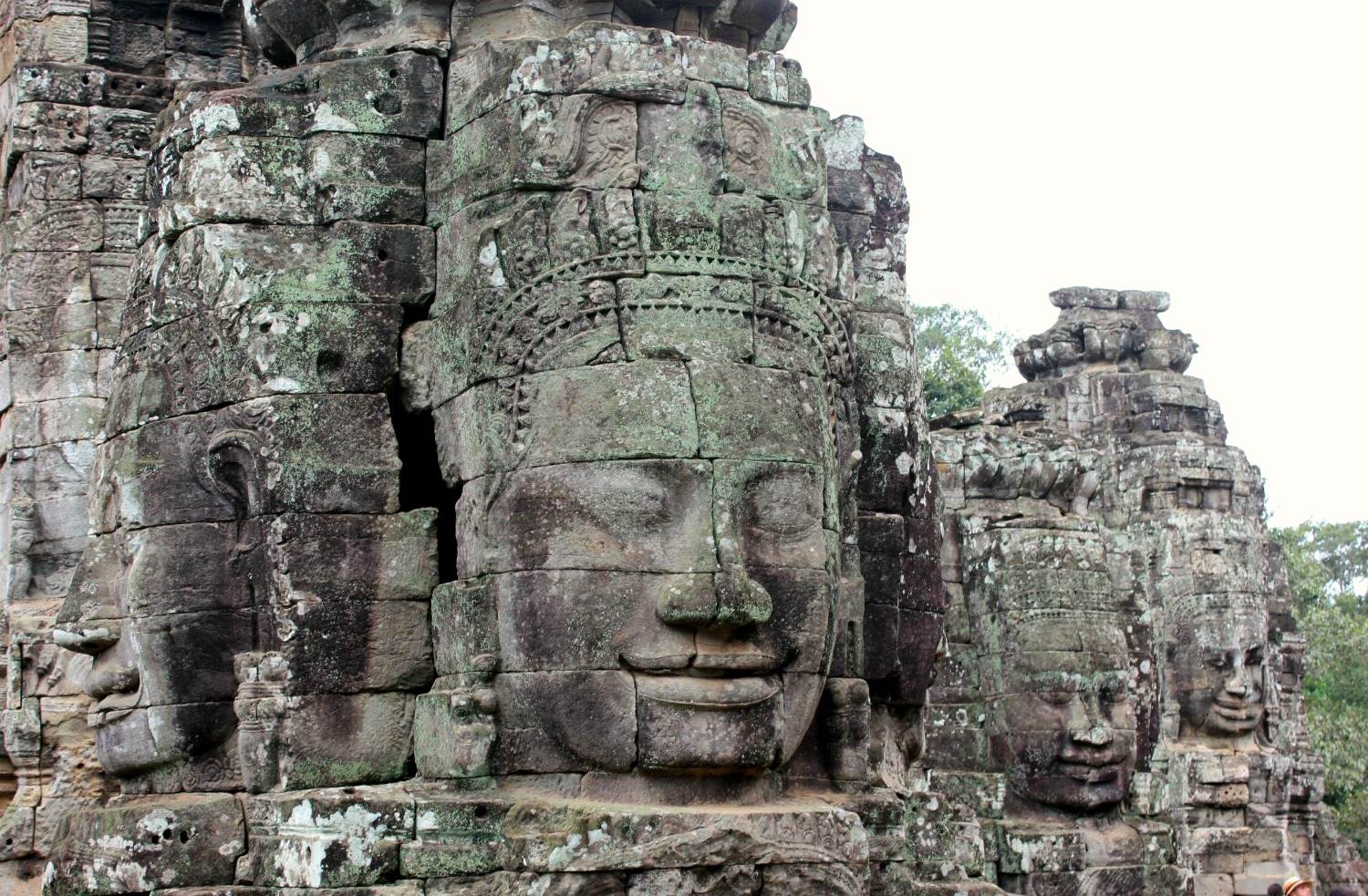 One of the huge carved faces at Bayon - 12 reasons to visit Cambodia with kids
