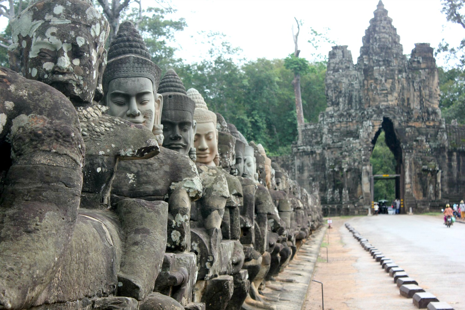 The line of statues along the bridge at Angkor Thom - 12 reasons to visit Cambodia with kids