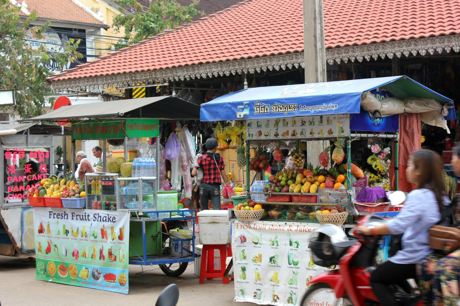 Brightly coloured fruit shake stalls in Siem Reap - 12 reasons to visit Cambodia with kids