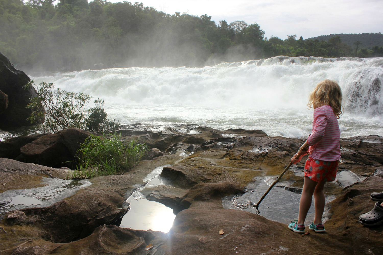 My daughter by the edge of the Tatai waterfalls -- discovering Cambodia's Cardamom Mountains with kids