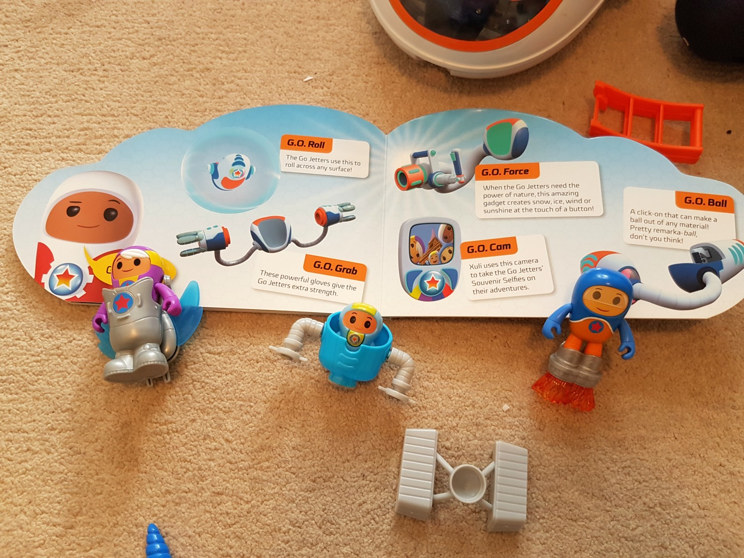 Several Go Jetters figures lined up by the new Go Jetters: Jet Set Go Board book - my Go Jetters Jet Set Go review and giveaway