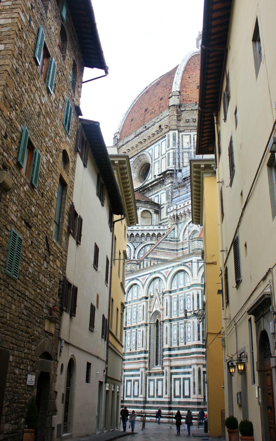 A view of the Duomo through an alleyway in Florence, Italy - my Uffizi tour with kids and gelato making day in Florence