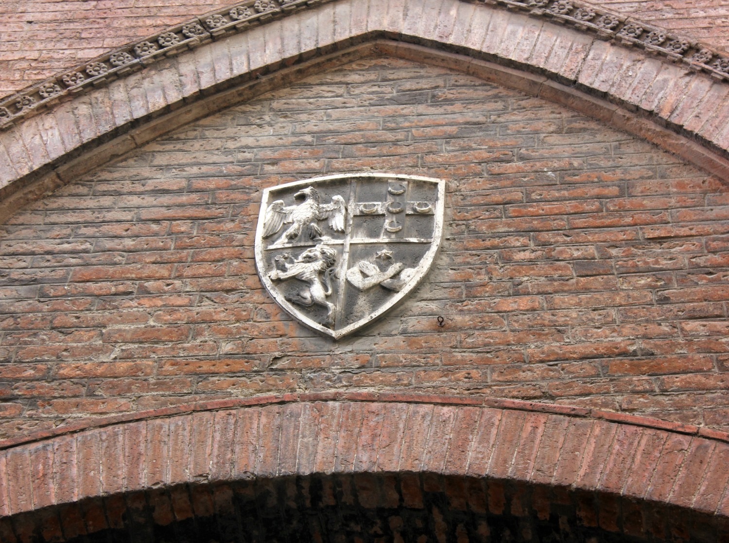 One of the shields and emblems showing the animals and symbols representing Siena's 17 areas or contrada - exploring Siena with kids, our tour discovering art, history and animals