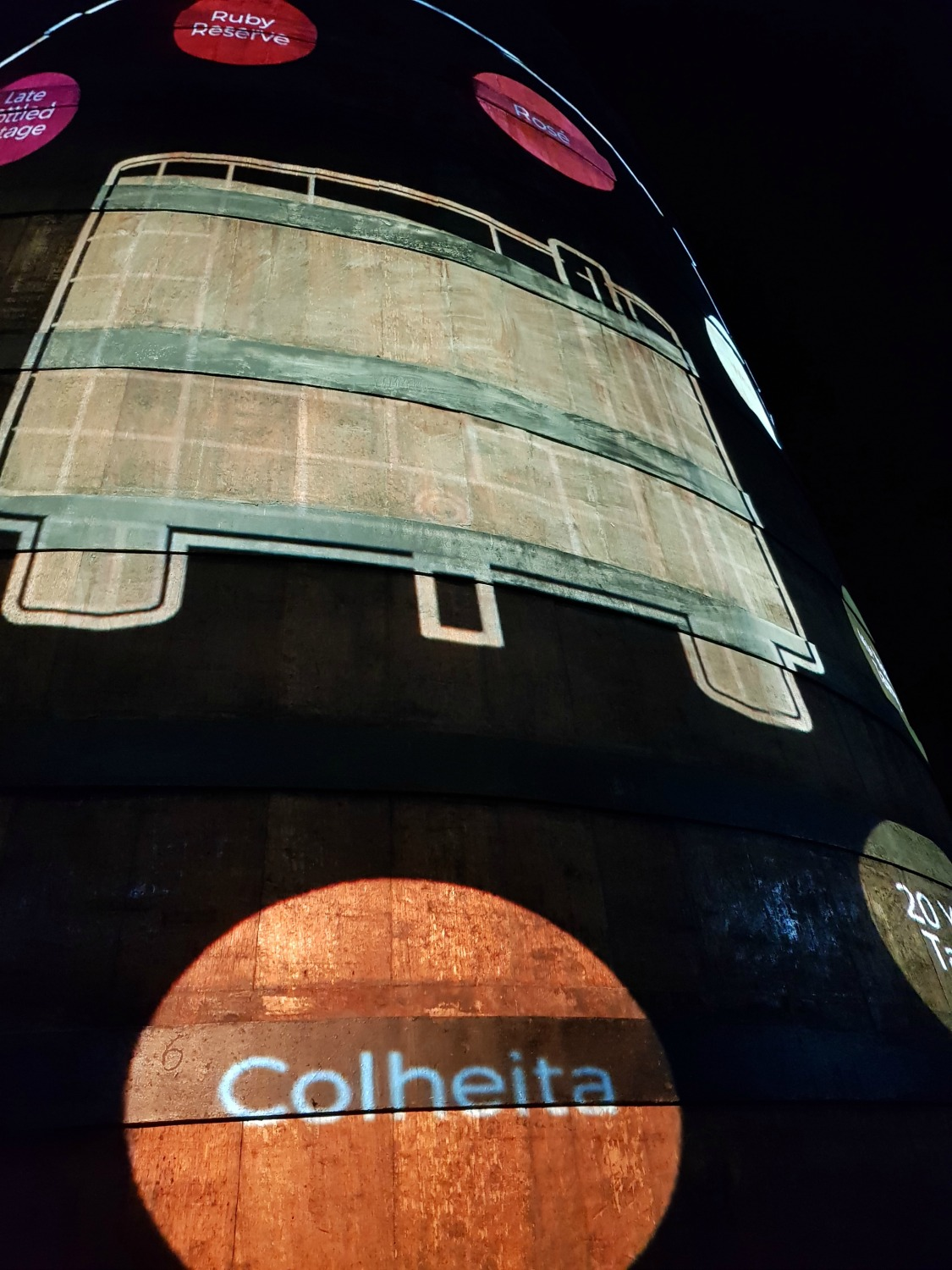 A display shone onto one of the huge port barrels as part of the tour of the cellar at Caves Calem in Vila Nova de Gaia, across the river from Porto - my Porto travel tips and lessons for visiting with kids