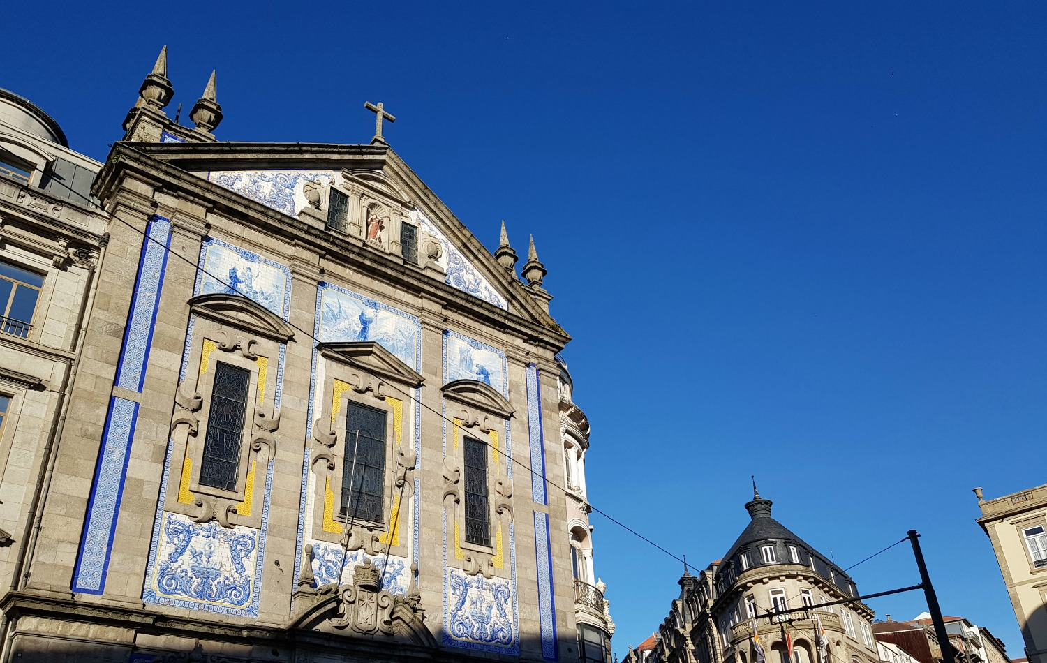 Tiled church against a blue sky in Porto - my Porto travel tips and lessons for visiting with kids