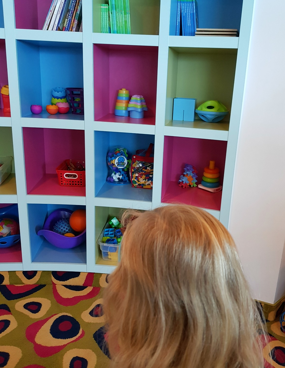 My daughter looking at some of the toys and games on board - testing out Anturus Explorer Academy kids club activities from Celebrity Cruises