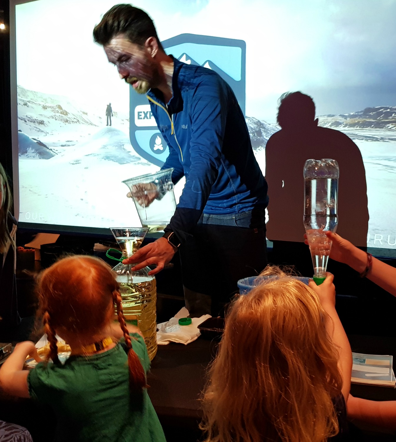 Discovering how a clear funnel disappears in oil as part of the science show - testing out Anturus Explorer Academy kids club activities from Celebrity Cruises