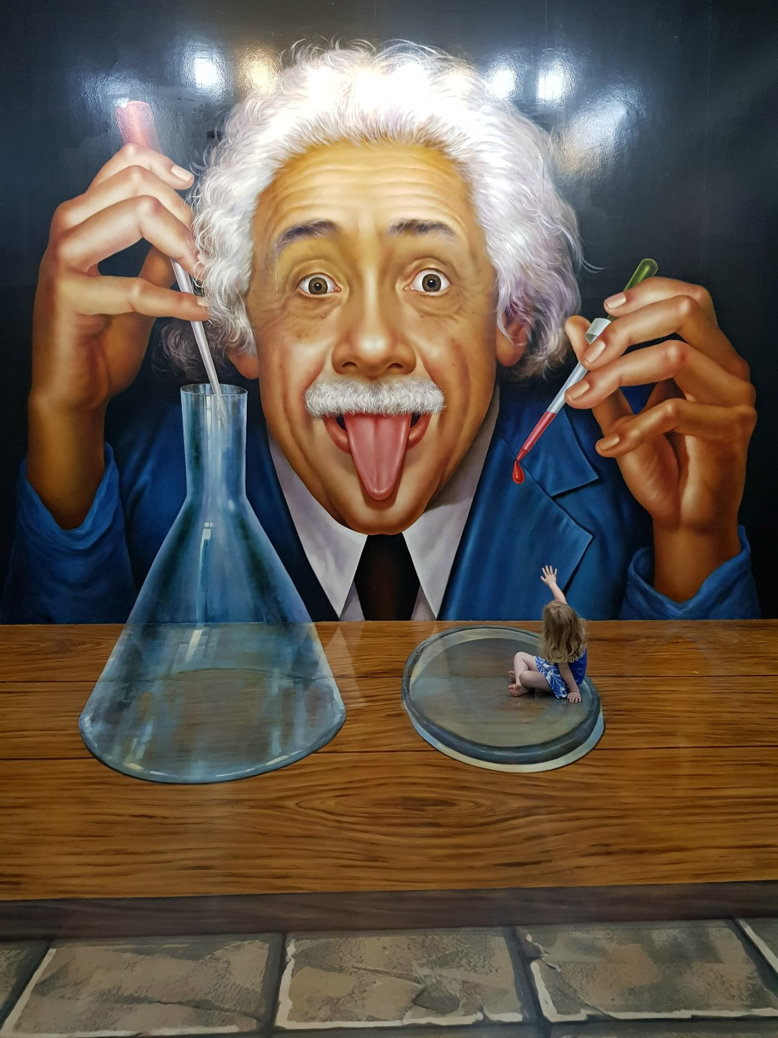 My daughter in a petri dish as Einstein conducts an experiment at Langkawi Art in Paradise, one of Malaysia's 3D art museums