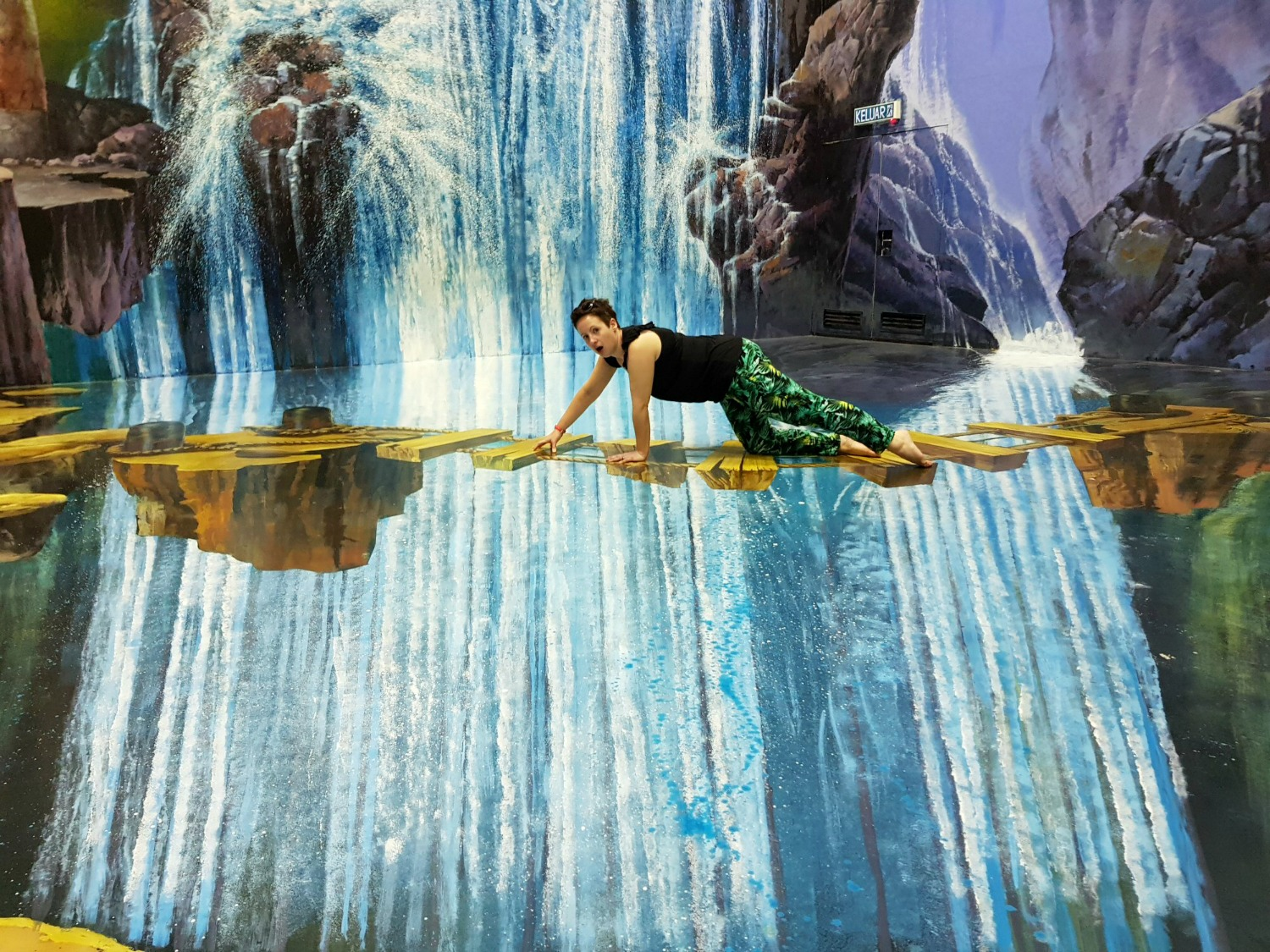 Me clambering over a precarious bridge by a waterfall at Langkawi Art in Paradise, one of Malaysia's 3D art museums