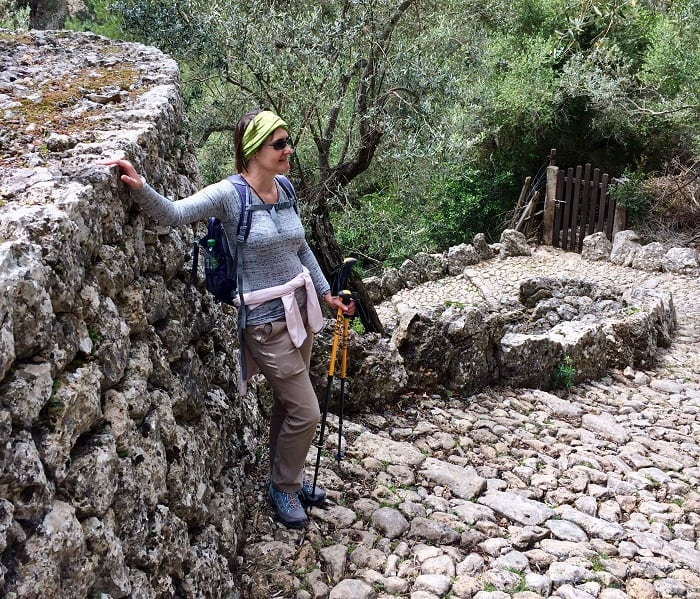 walker on cobbled paths of gorge in mallorca