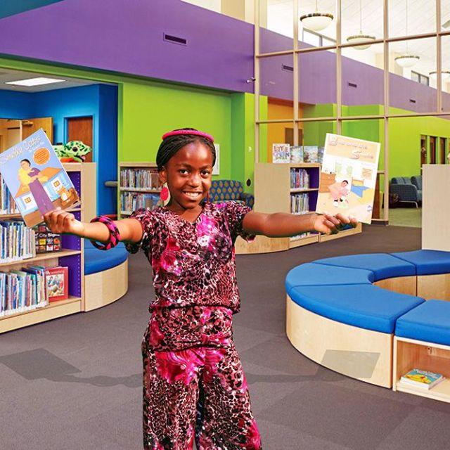 Stacey-Fru-holding-five-books_muna-kalati