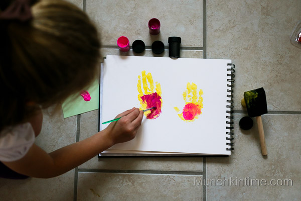 Girl Minions in pink Handprint Art from www.munchkintime.com-7