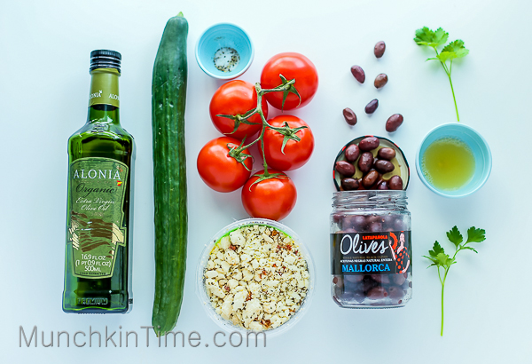 Greek Cucumber Salad made of crunchy cucumber, ripe tomatoes, feta cheese, black olives and easy to make 3-ingredient dressing -- #greekcucumbersalad www.munchkintime.com