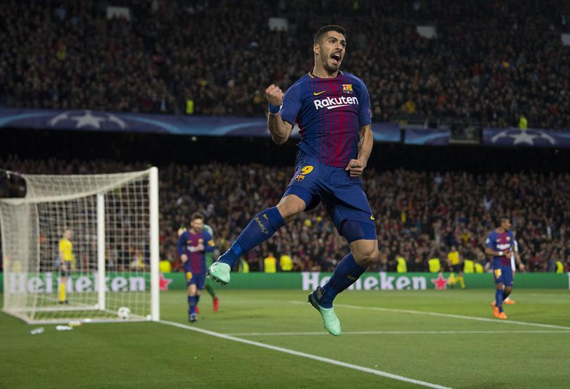 Luis Suárez celebra con rabia el cuarto gol ante la Roma.
