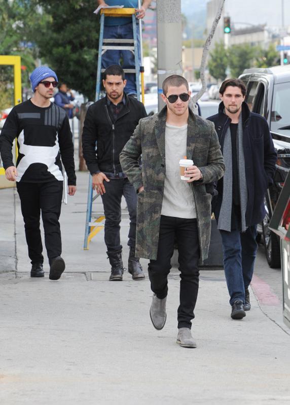 Nick and Joe Jonas with actor Wilmer Valderrama in 2016.