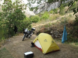 Bike and tent safely ensconced in the corner of a campsite