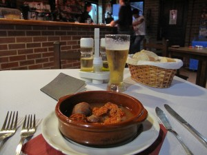 A plate of chorizos in cider and a pint of cold beer - heaven!