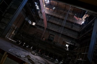 The letters CCCP have been arranged at the foot of the crumbling stage in Pripyat's former theatre