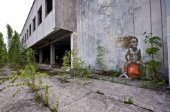 A painting of a laughing child on a space-hopper adorns the side of Pripyat's derelict supermarket