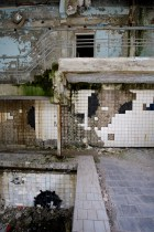 Tiles peel off the pool wall to reveal minesweeper style graffiti
