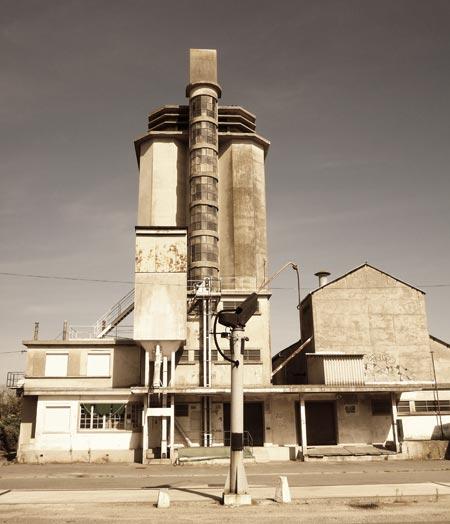 Art-deco style grain silo in French village